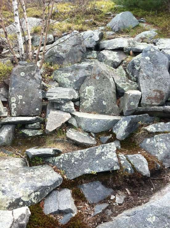 4 granite chairs built into hillside by ccc
